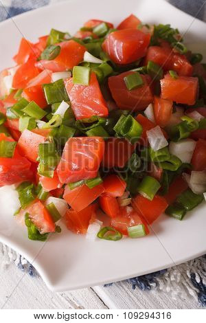 Salted Salmon Salad With Tomatoes And Green Onions Close-up. Vertical