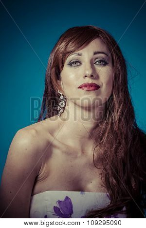 Beautiful red haired woman in white dress with flowers and sensual look on clean background, smile and beauty