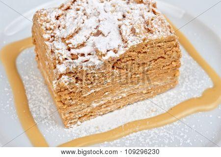Cake Napoleon at plate closeup photo