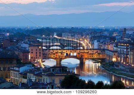 Florence, Italy night skyline. Ponte Vecchio bridge over Arno River. Tuscany