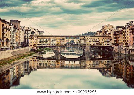 Ponte Vecchio bridge in Florence, Italy. Arno River. Retro, Vintage Tuscany