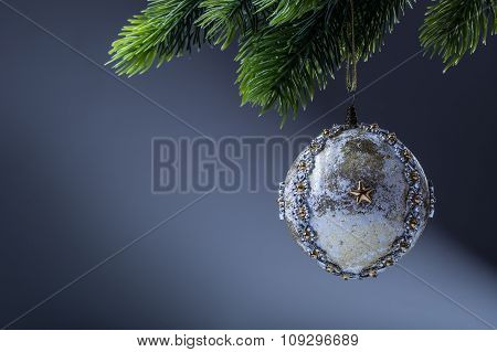 Christmas ball. Luxury christmas ball on christmas tree. Home made Christmas ball hanging on pine tw