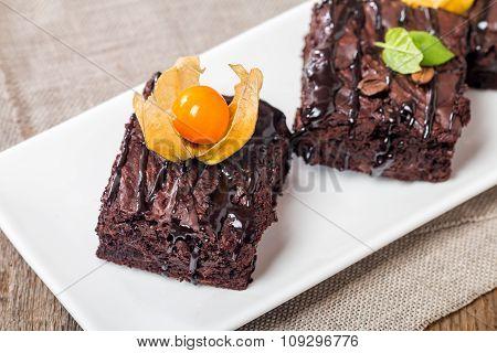Homemade Chocolate Brownie On A White Plate
