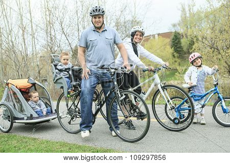 Family having fun on bikes