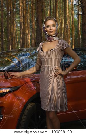 Lady In Vintage Dress Standing Near Car