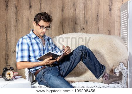 Man Relaxing On Sofa Couch Reading Novel Story Book