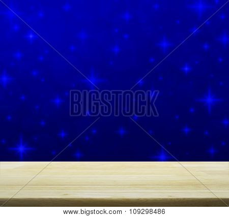 Empty Table Over Blue Blur Light With Shiny Starry, Christmas Background