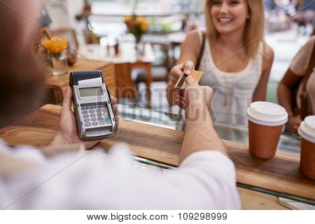 Customer Paying At A Cafe With Credit Card