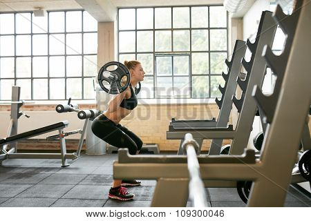 Fitness Female Doing Squats In Gym