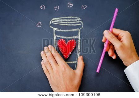 Men's Hand Hold Glass Of Coffee On A Chalkboard For Valentine's Day