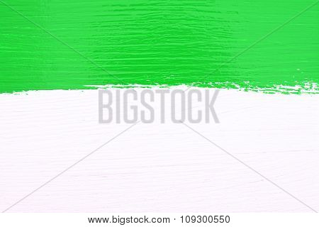 Stripe Of Green Paint Over White Wooden Background