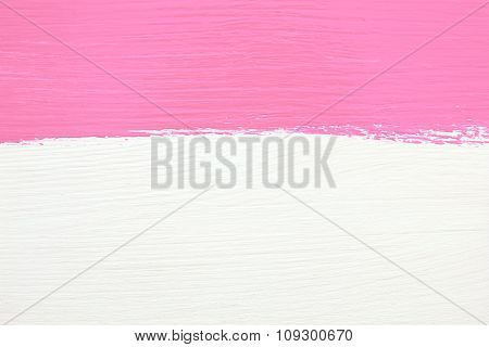 Stripe Of Pink Paint Over White Wooden Background