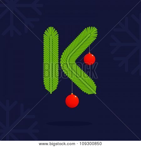 K Letter Formed By Christmas Decorative Fir-tree Branches And Balls.