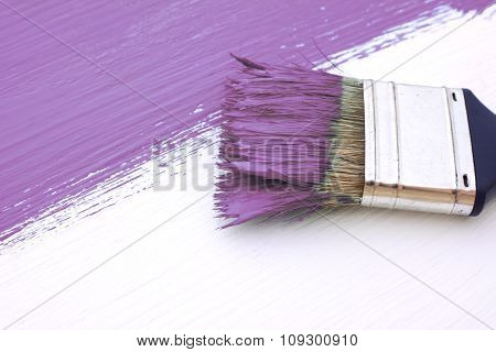 Close-up Of Paintbrush Painting A White Board Purple