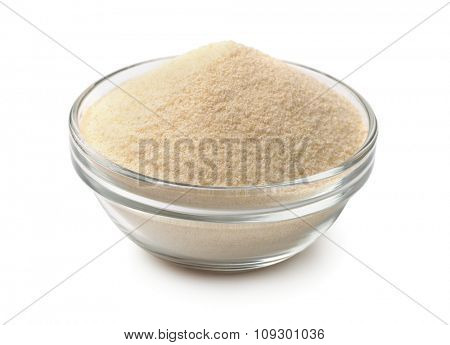 Bowl of semolina isolated on white