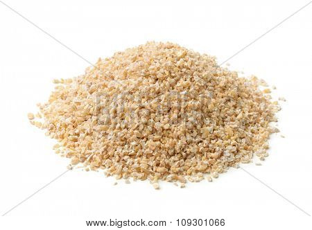 Heap of barley grits isolated on white