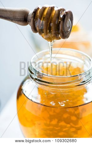 Dripping Honey Into Jar