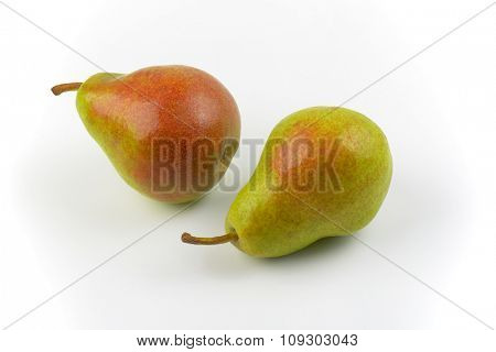 close up of two ripe pears on white background