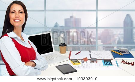 Woman architect in amodern office. Construction and renovation concept.
