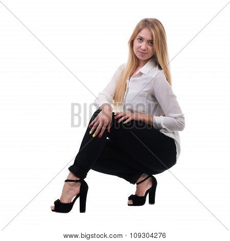 Full length of beautiful blond business woman sitting over white background with copy space