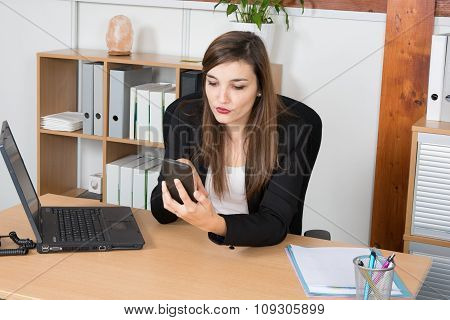 Image Of A Businessperson Dialing A Number Using The Smartphone On The Foreground