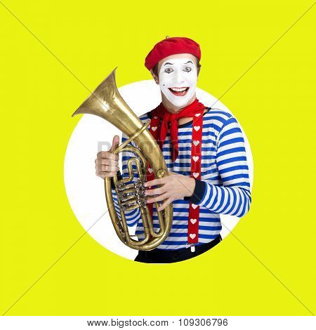 Mime with trombone.Emotional funny actor wearing sailor suit, red beret posing on color white green