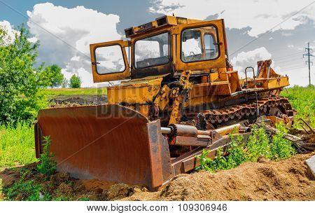 Bulldozer On Construction Site Beneath Cloudy Sky