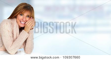 Beautiful casual woman portrait over blue abstract background.
