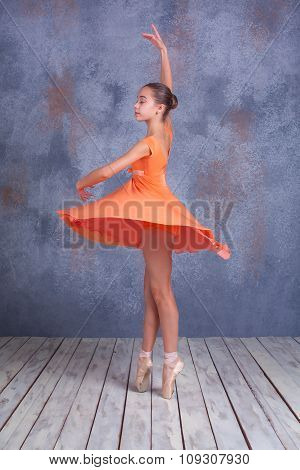 The young ballerina dancing