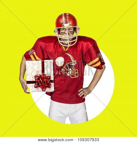 American football player in red uniform posing with big gift on color background