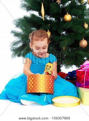 elegant girl near the Christmas tree