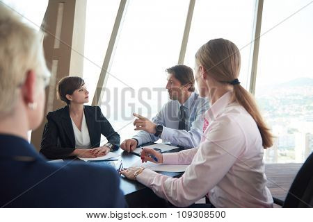 business woman on meeting, people group in background at modern bright office indoors