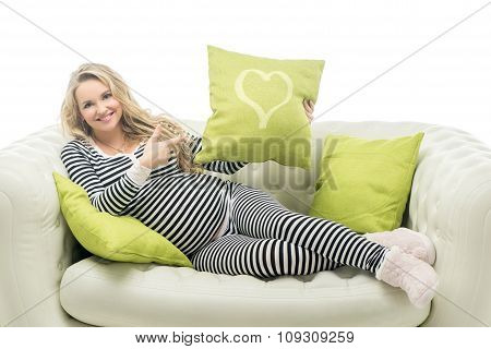 Pregnant woman in striped black and white costume