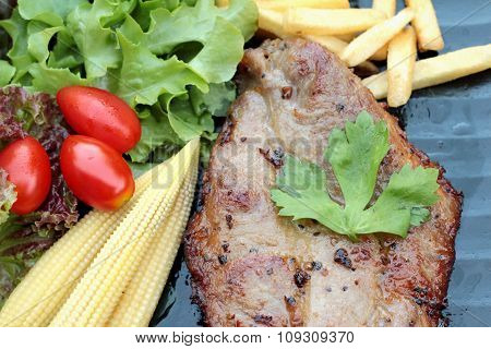 Pork Steak Of Delicious With Vegetable And Tomato.