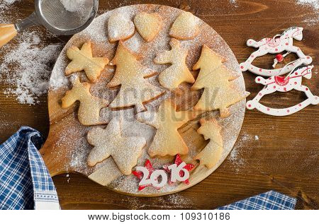 Homemade Christmas Cookies On  Wooden Board.