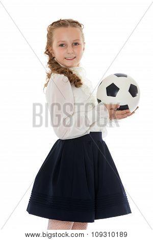 Schoolgirl with soccer ball