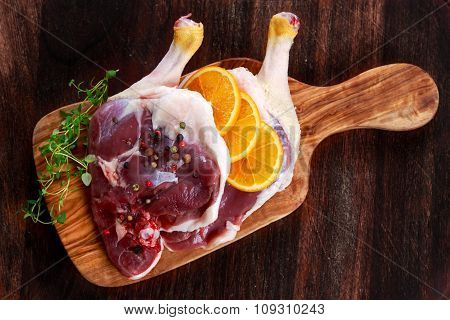 Free Range Duck Legs With Oranges And Herbs. On Old Wooden Table