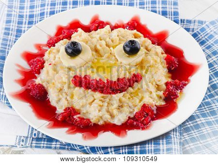 Smiling Oatmeal And Fresh Berries For Breakfast.