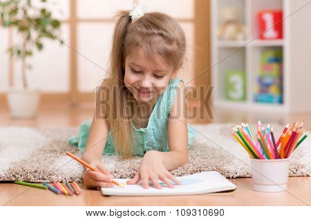 Child little girl child kid drawing at home