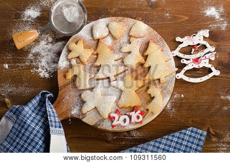 Homemade Christmas Cookies On A Wooden Board.