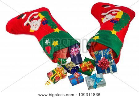 Christmas Stockings And Gifts Isolated Over White.