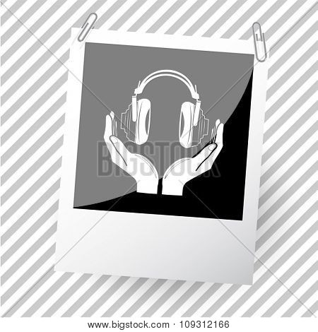 headphones in hands. Photoframe. Raster icon.