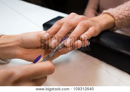 Removing the cuticle by manicure nippers