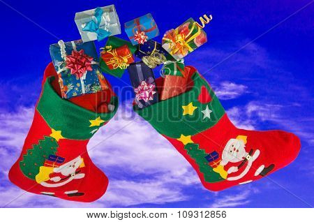 Christmas Stockings And Gifts In The Sky.