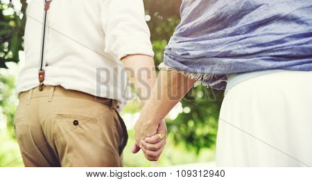 Mature Couple Walking Together Outdoors Concept