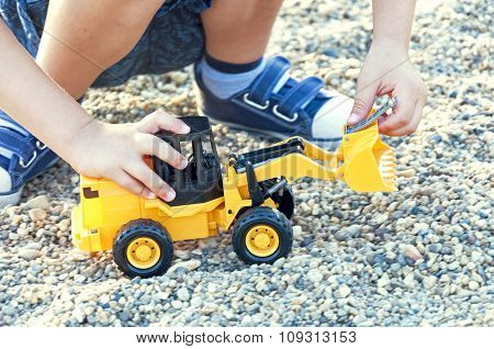 Kid Plays With Toy Excavator