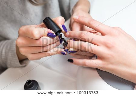 Beautiful manicure process with nail polish
