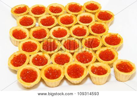 Tartlets with salmon caviar, salmon ROE.