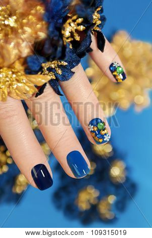 Blue and gold manicure.