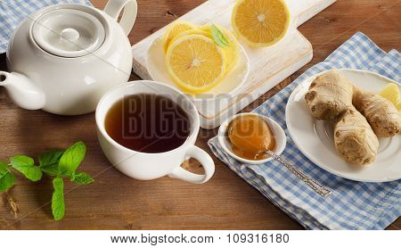 Teapot And Cup Of Tea With Lemon, Ginger, Honey  And Mint
